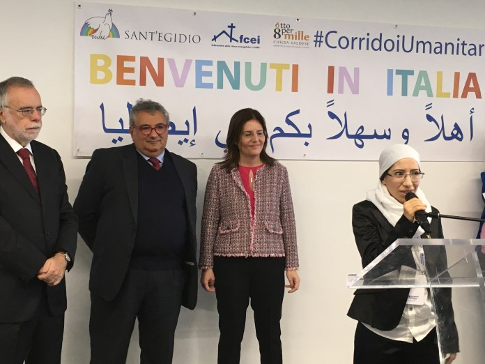 Yasmin_greets_new_refugees_arriving_at_the_Leonardo_da_Vinci_airport_in_Rome.jpg