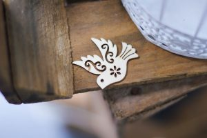 image of a wooden dove on a wooden crate